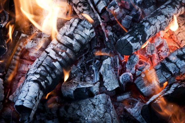 Closeup of Firelogs on Fire in a Fireplace